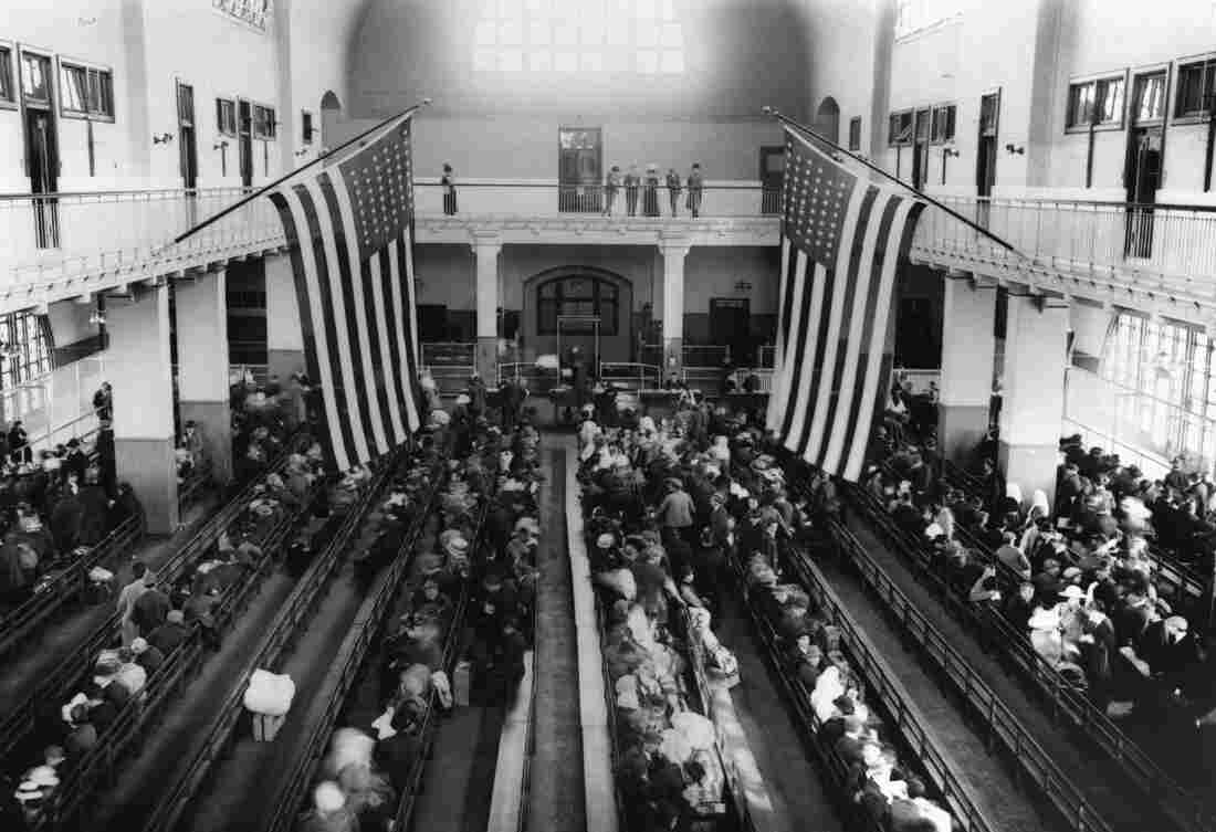 Immigrants wait in a registration room on Ellis Island in 1912.