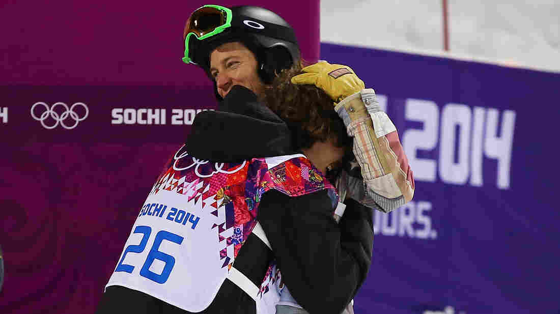 Shaun White, right, congratulates gold medalist Iouri Podladtchikov of Switzerland after the Snowboard Men's Halfpipe Finals of the Sochi 2014 Winter Olympics Tuesday.