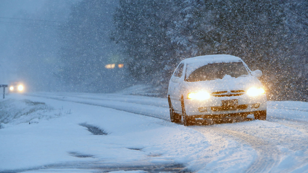 This car was navigating a snowy road early Tuesday in Fort Payne, Ala. The wicked winter weather there is spreading across the Deep South. (AP)