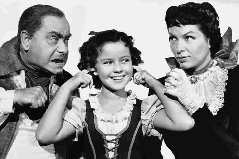 Temple with Eddie Collins and Gale Sondergaard from a scene of the 1940 movie The Blue Bird.