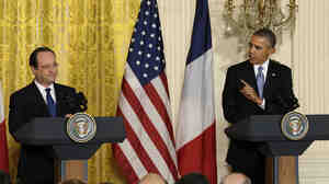 President Obama gestures toward French President Francois Hollande during their joint news conference on Tuesday.