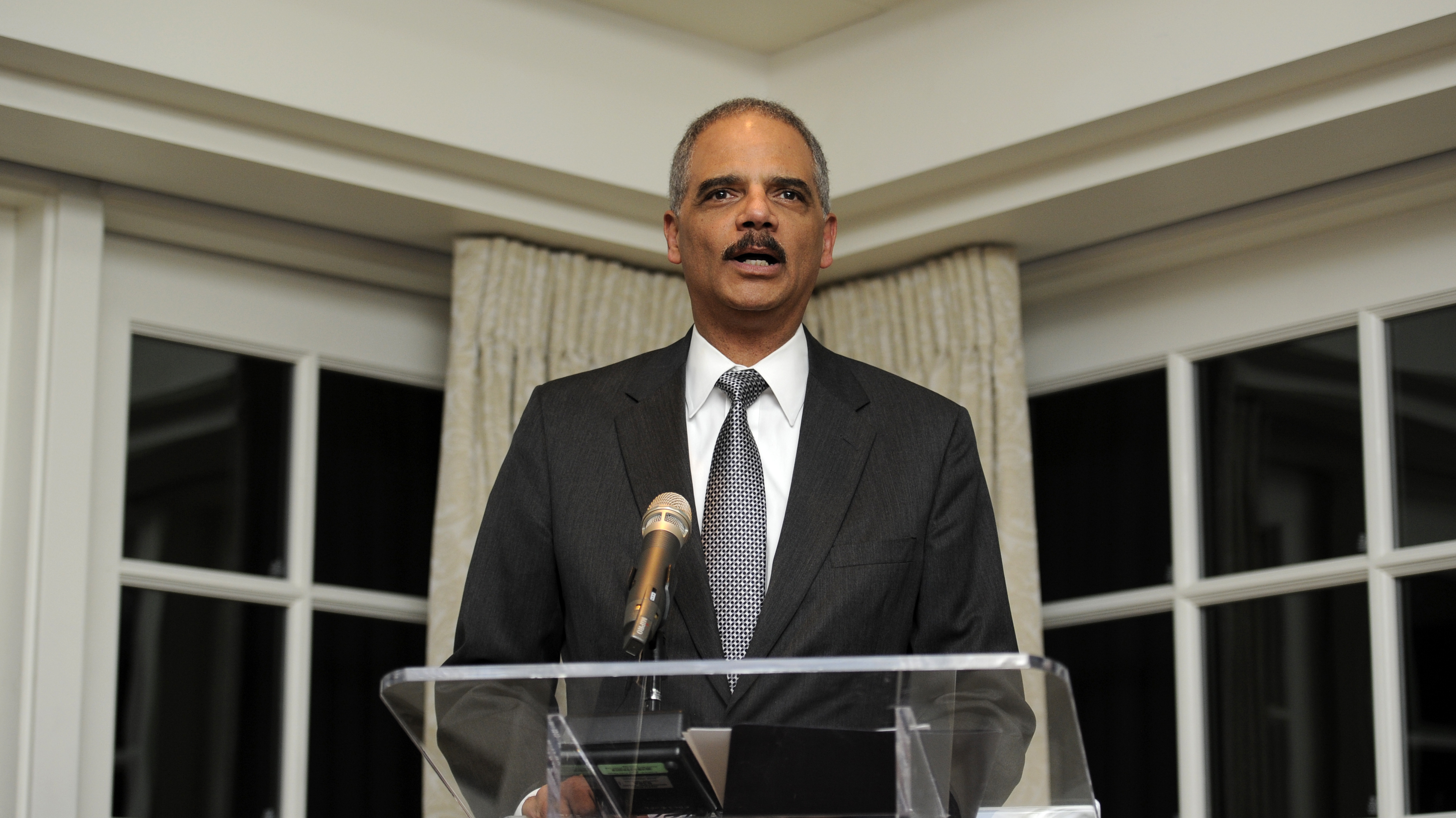 Holder Calls For Restoring Felons' Voting Rights