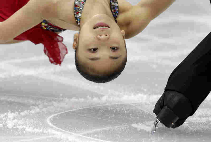 Narumi Takahashi and Ryuichi Kihara of Japan compete in the pairs short program figure skating competition at the Iceberg Skating Palace during the 2014 Winter Olympics on Tuesday in Sochi, Russia.