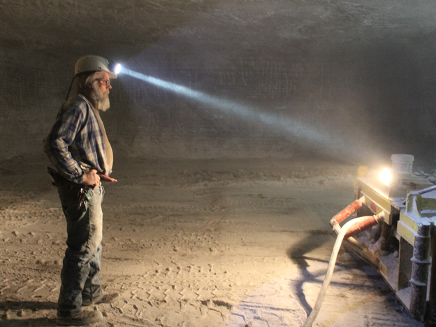 Salt miner Lewis Lavy rests for a moment before drilling another wall of rock salt.