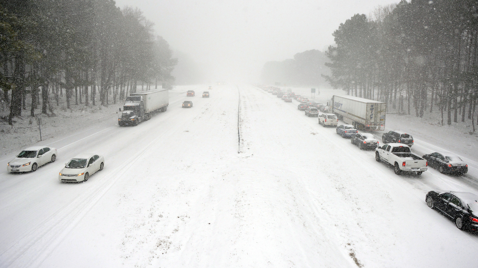 Traffic creeps along Wade Avenue in Raleigh, N.C., where commuters were caught on roads despite officials' encouragement not to travel. (Getty Images)