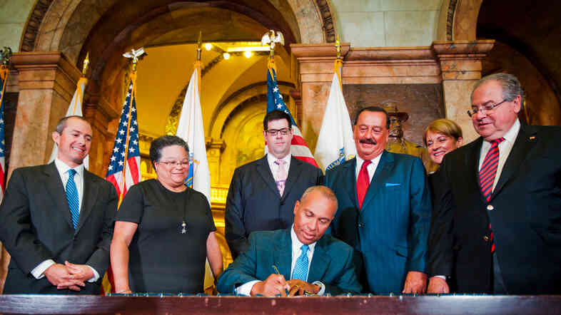 Governor Deval Patrick of Massachusetts signed the law enacting the state's latest phase of health care on August 6, 2012.