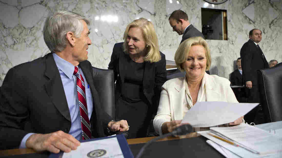 New York Sen. Kirsten Gillibrand (center) and Missouri Sen. Claire McCaskill (right) are at odds over the best way to respond to military sexual assaults.