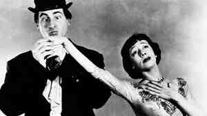 Sid Caesar and Imogene Coca in a scene from Your Show of Shows. Caesar, whose sketches lit up 1950s television, died Wednesday at 91.