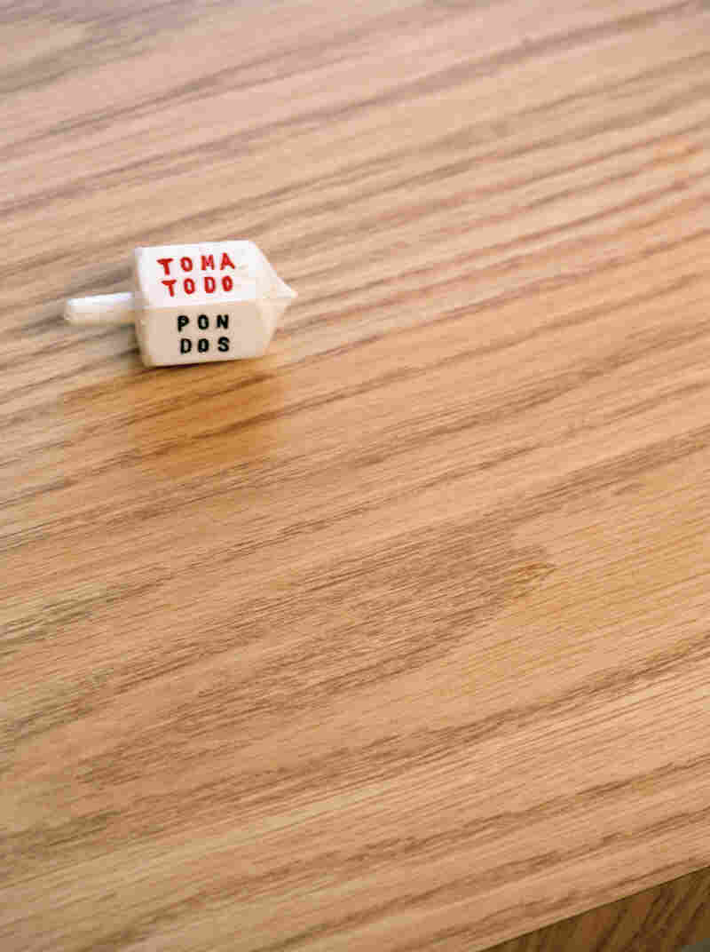 This dreidel-like Mexican top is used to play a similar game called toma todo. Its origins are unclear.