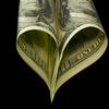A $100 bill folded into a heart