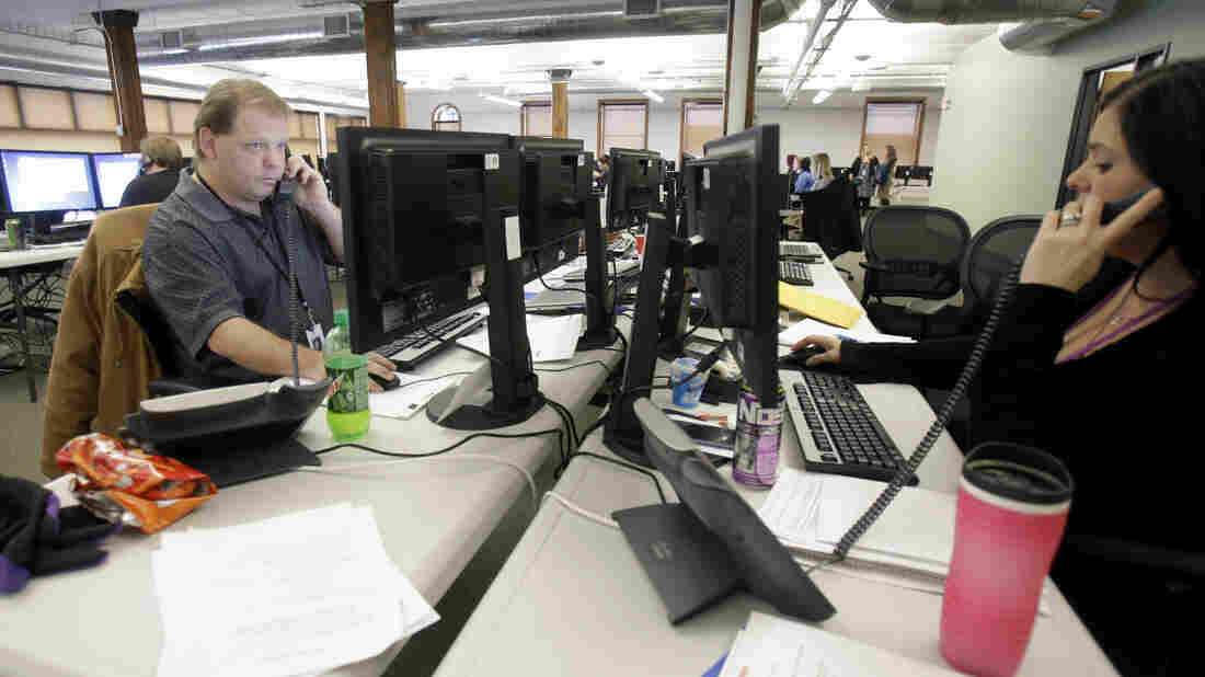 Insurance guides work the phone bank at MnSure, Minnesota's heal