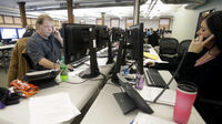 Insurance guides work the phone bank at MnSure, Minnesota's health exchange, in St. Paul, Minn., in December.