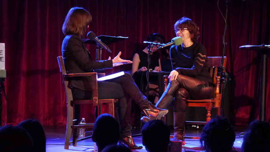 Ask Me Another host Ophira Eisenberg chats with Very Important Puzzler Delia Ephron on stage at The Bell House in Brooklyn, NY.