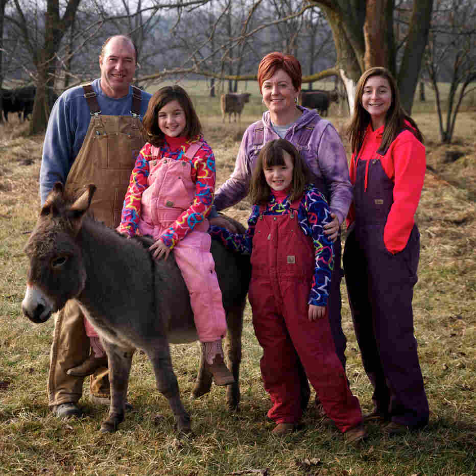 The Sayles family on their farm in Michigan. Julie and Rick Sayles met through the site FarmersOnly.com five years ago.