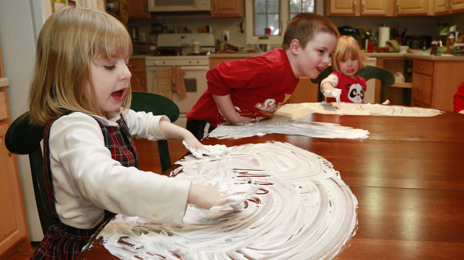Last week in Indianapolis, the Kehoe children — from left, Maria, Anthony and Veronica — played with shaving cream as their mother Joanne tried to keep them occupied when the weather outside was awful. (AP)