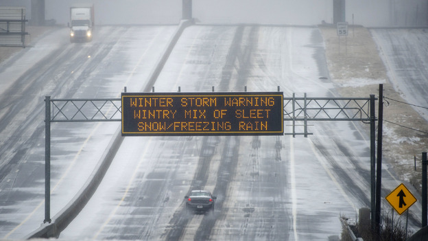 Not a good day for a drive: A Georgia Department of Transportation sign warned motorists in Norcross Wednesday morning, and few were on the roads. (AP)