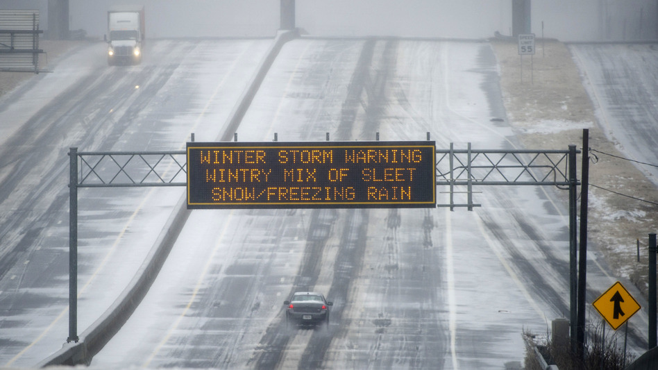 Not a good day for a drive: A Georgia Department of Transportation sign warned motorists in Norcross Wednesday morning, and few were on the roads.