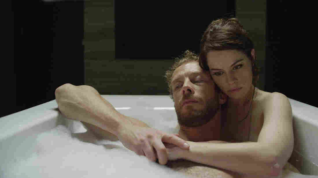 Kate (Emily Hampshire) treats the victims of zombie attacks — among them her husband, Alex (Kris Holden-Reid), in a world where medication can keep the zombie-bitten human, but supplies may be running low.