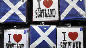 A display of T-shirts are seen for sale in a Scottish memorabilia shop in Edinburgh, Scotland, on Jan. 13, 2012. Scotland votes in September on independence, but the U.K. government has warned that freedom will come at a cost: Scotland will lose the pound.