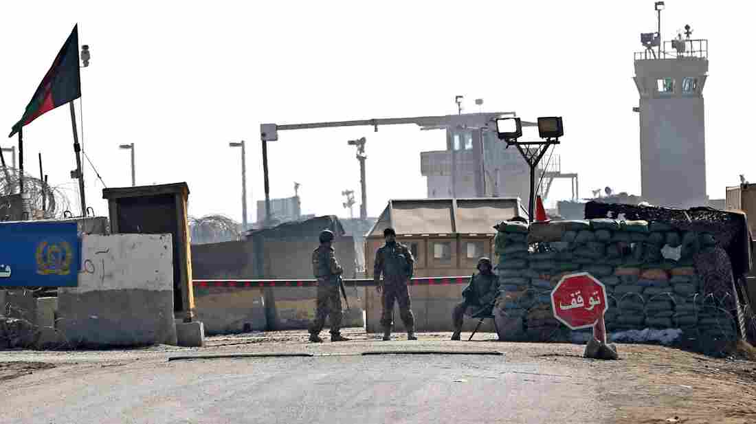 Afghan National Army soldiers stand guard at the main gate of the Parwan Detention Facility Center on the outskirts of Bagram. Afghan authorities released 65 prisoners from there Thursday.