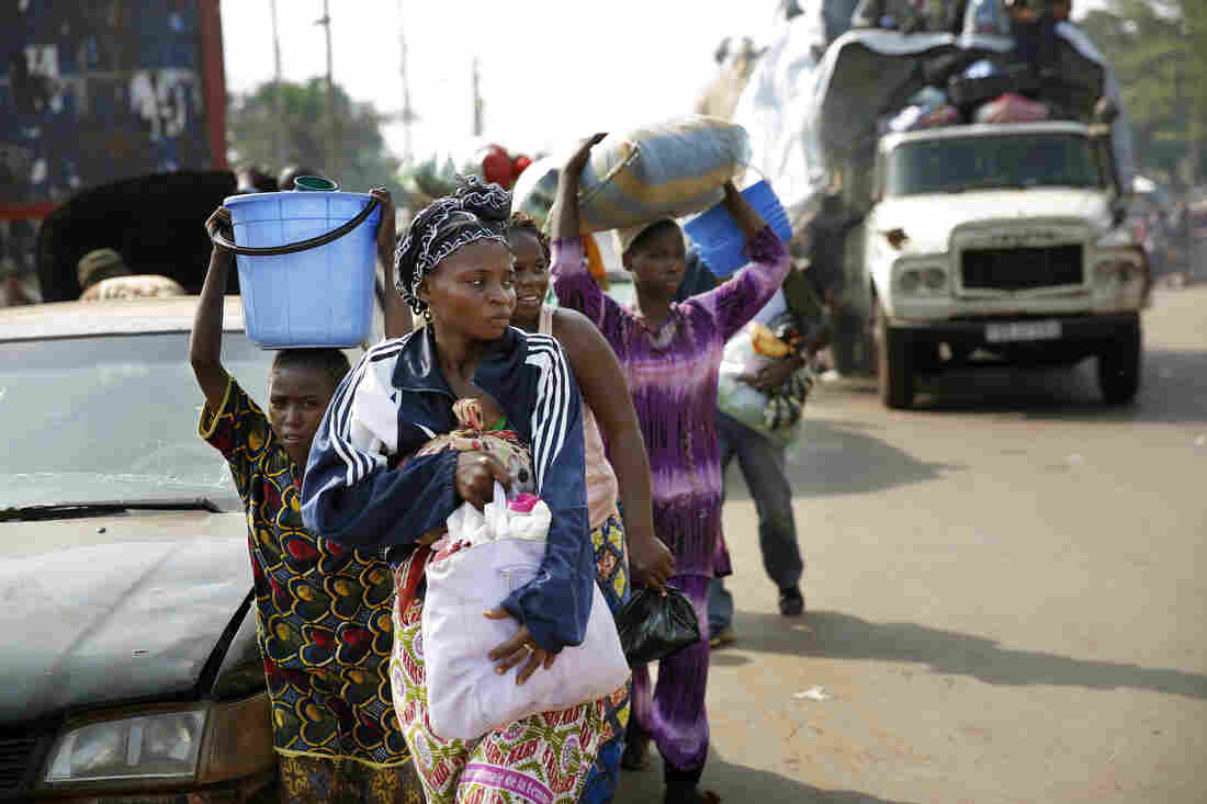 Thousands of Muslim residents flee Central African Republic capital Bangui in a mass exodus using cars, trucks and motorcycles, escorted by Chadian troops, on Feb. 7.