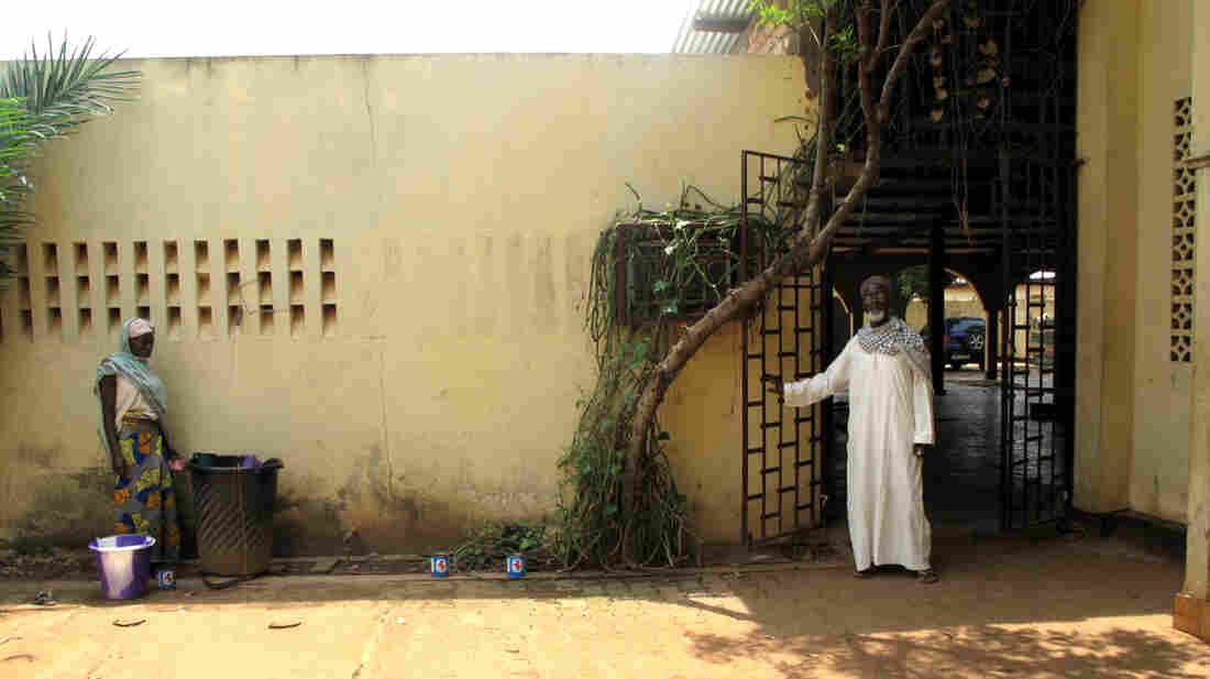 Wazili Yaya (right) stands outside the Ali Babalo Mosque in the capital Bangui. Once home to thousands of Muslims, the neighborhood is now virtually empty.