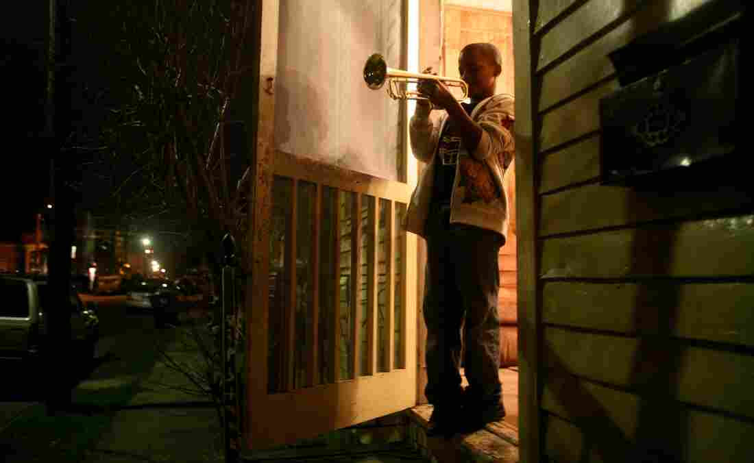 """Eleven-year-old Jaron """"Bear"""" Williams practices trumpet before marching in his first Mardi Gras season. The Whole Gritty City follows young student marching bands as they prepare for coveted spots in the New Orleans parade."""