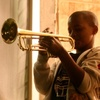 "Eleven-year-old Jaron ""Bear"" Williams practices trumpet before marching in his first Mardi Gras season. The Whole Gritty City follows young student marching bands as they prepare for coveted spots in the New Orleans parade."