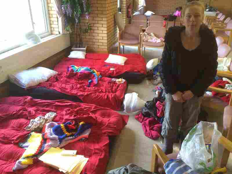 Priscilla Smithers and her four children have arranged chairs around a few air mattresses to create a space for themselves, after fleeing their home.