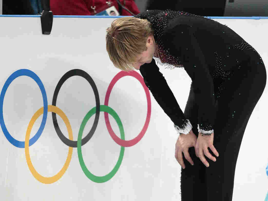 Evgeni Plushenko of Russia withdrew from the Sochi Olympics on Thursday, reportedly because of a recurring problem with his back.