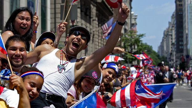 Parade onlookers cheer marchers in last year's National Puerto Rican Day Parade in New York.