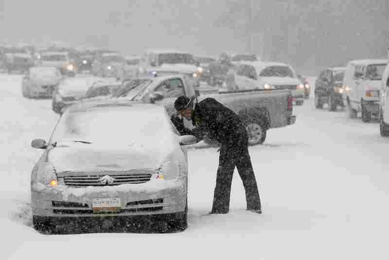 A Highway Patrol officer checks on the safety of a stranded motorist in Raleigh, N.C.