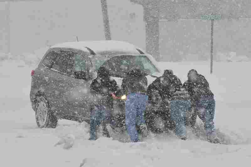 Good Samaritans help push a stranded motorist stuck in deep snow in Bethlehem, Pa.