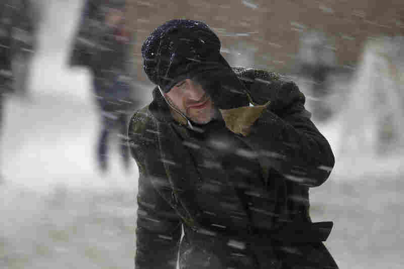 A commuter makes his way through heavy snow in New York City.