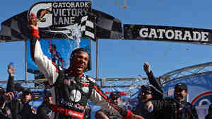 Darrell Wallace Jr., a graduate of NASCAR's Drive for Diversity Program, celebrates after winning the NASCAR Camping World Truck Series Kroger 200 at Martinsville Speedway on Oct. 26 in Martinsville, Va.
