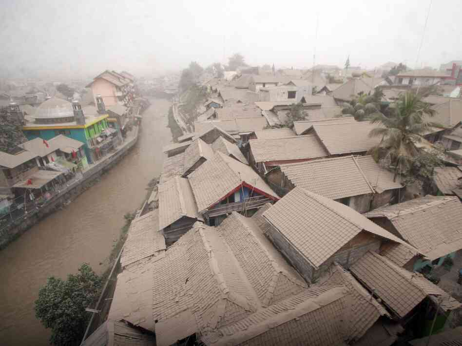 A residential area is covered with ash from the Mount Kelud volcano, in Yogyakarta, Indonesia, on Friday.