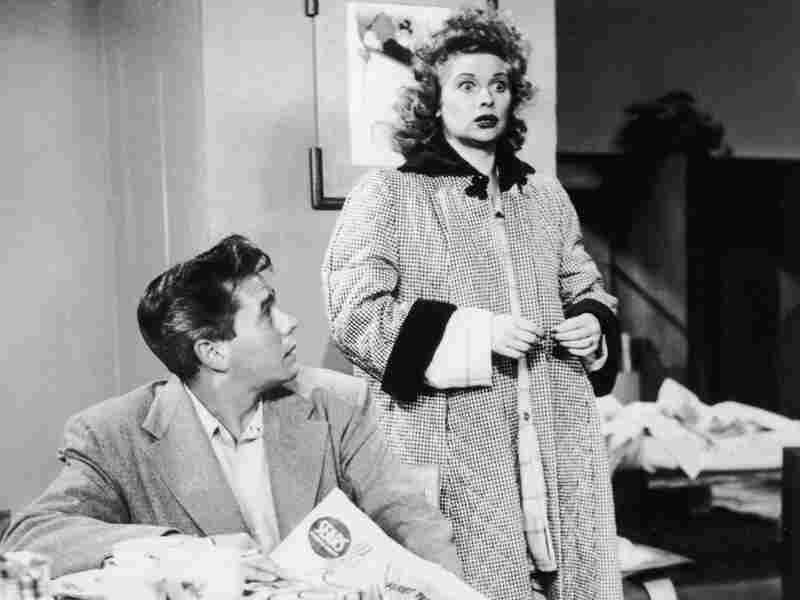 American actor Lucille Ball and Cuban-born actor Desi Arnaz star as a married couple in the television series, I Love Lucy in 1956. The pair were also married in real life.