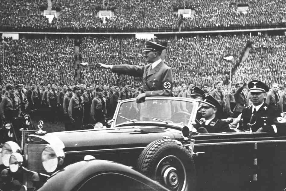 Adolf Hitler salutes to a crowd of soldiers at a Nazi rally in 1938. Years later, in the final months of World War II, the United States undertook an enormous effort to attract Nazi scientists.