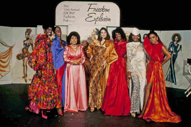 Ebony Fashion Fair founder and director Eunice Johnson (in pink) stands with models during the 33rd annual Fashion Fair in 1991.