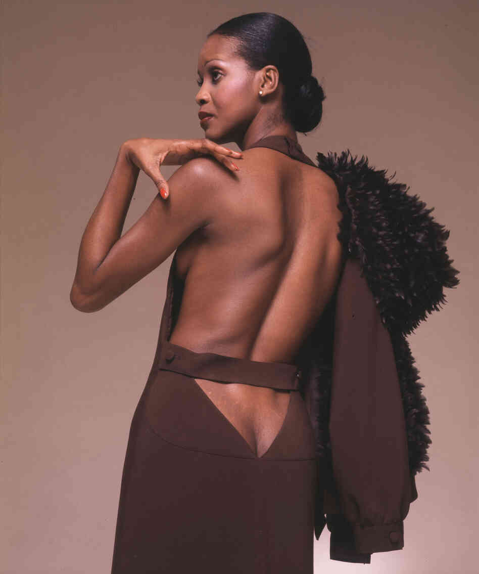 A backless gown with a feather-trimmed hoodie from French designer André Courrèges, 1974.