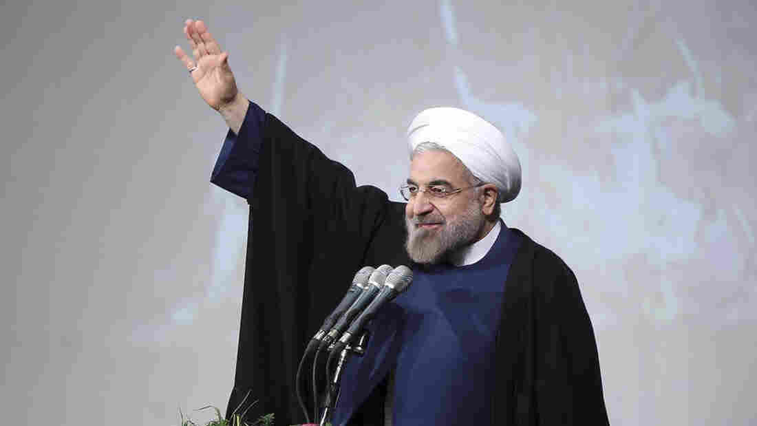 Iran's President Hassan Rouhani speaks to students at Shahid Beheshti University in Tehran in December. Rouhani says he wants to create more opportunities, but many college-age Iranians are skeptical about the pace of change and some are looking to go abroad.