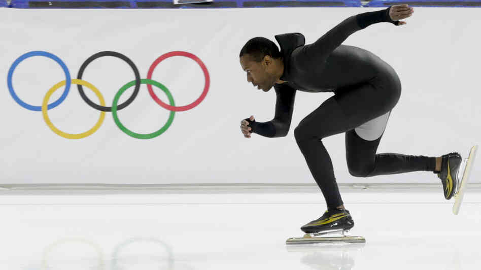 Shani Davis of the U.S. skates in the prototype of the official US Speedskating suit during a training session at the Adler Arena Skating Center in Sochi, Russia, Friday. As U.S. skates have fallen short of their goals at the Winter Olympics, some skaters have asked to switch to their old suits.