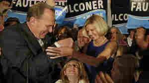 Kevin Faulconer reaches for his wife, Katherine, at a Feb. 11 rally as their daughter looks up from below. Faulconer, a Republican, won the San Diego mayoral race last week.