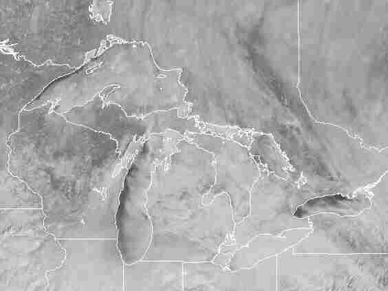 Another satellite image, with state lines superimposed on it, taken on Friday.