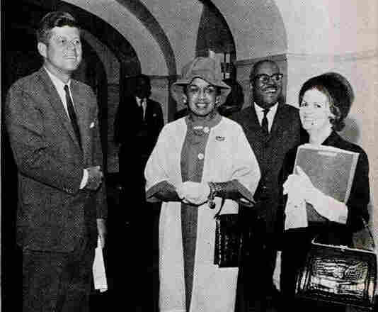Then-Fashion Fair director Freda DeKnight (center) stands with President John F. Kennedy when the models visited the White House. The photo was featured in the Oct. 26, 1961, issue of Jet Magazine.