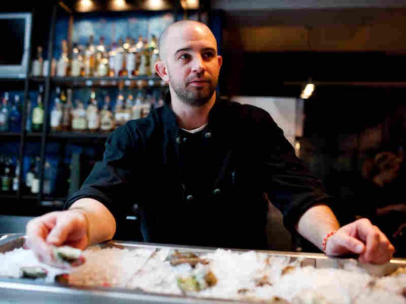 Fishmonger MJ Gimbar serves up some oysters at BlackSalt Fish Market & Restaurant in Washington, D.C.