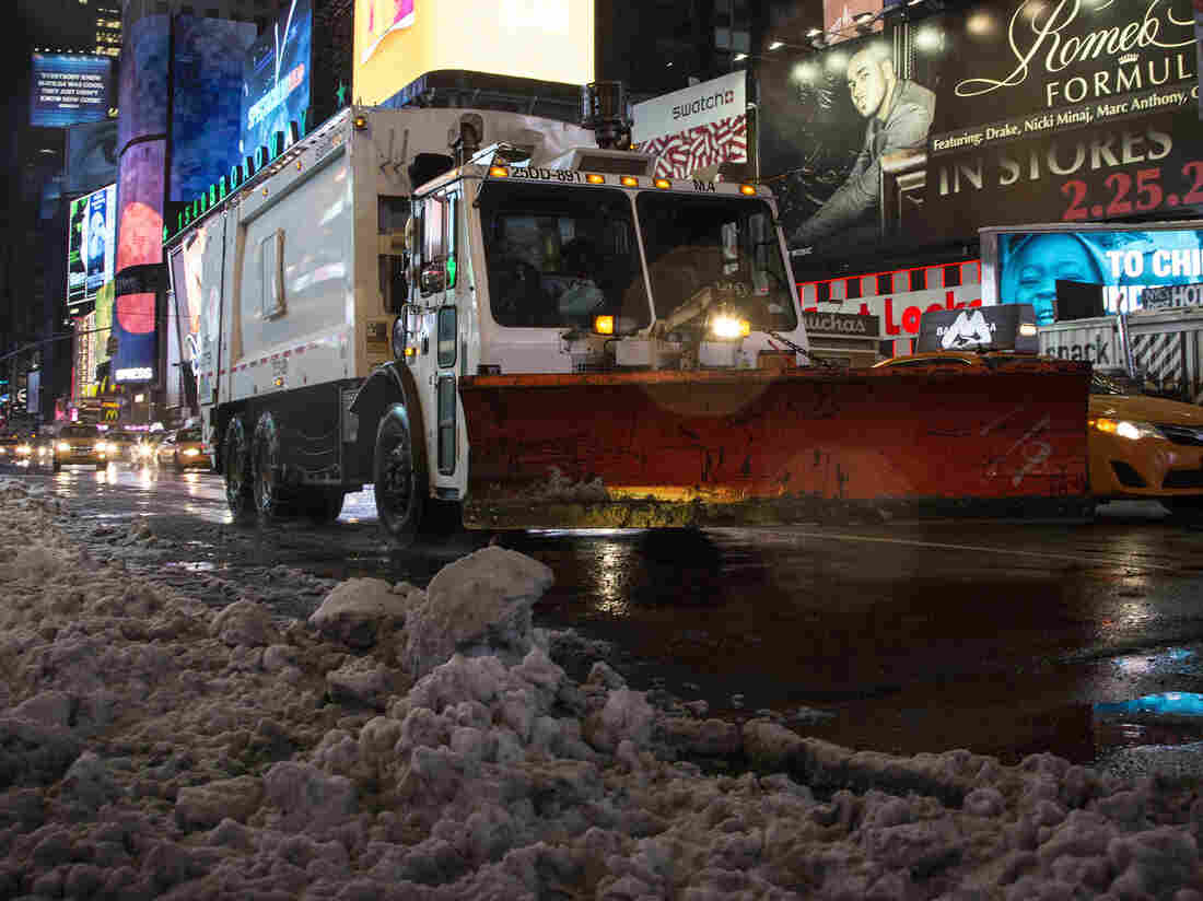In Times Square on Friday morning, plows were clearing away the snowy mess.