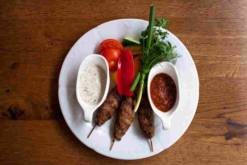 Kabobs are typical of the region, served with adjika, a spicy sauce made with fresh red peppers, garlic and spices.