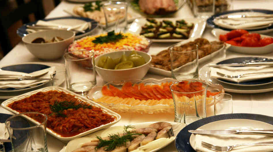 Zakuski tables, like Slava and Luba Frumkin's, are known for their largesse. This spread includes smoked salmon and halibut, pickled green tomatoes, salted mackerel, Herring Under a Fur Coat and Georgian eggplant rolls.