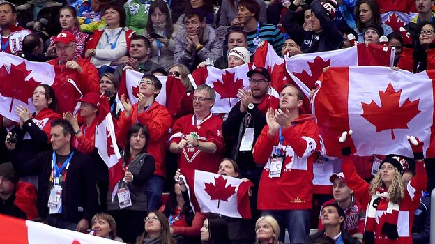Canada fans cheer during a men's hockey game between Austria and Canada at the Winter Olympics in Sochi, Russia, on Friday.